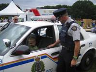Auxiliary Constable with child in PC