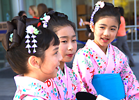 Young Asian Performers in Kimonas